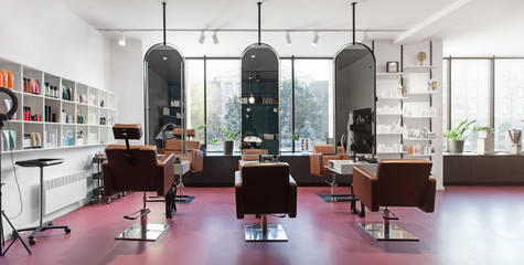 Chairs and mirrors in modern hairdressing, beauty salon