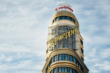 MADRID, SPAIN, 26TH DECEMBER, 2019: Famous Scheweppes building in Gran Via