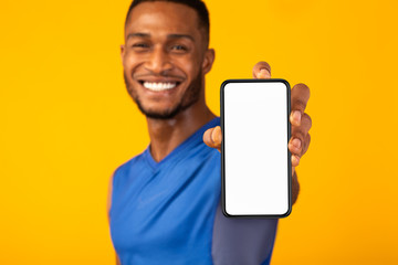 Black millennial gman showing white blank phone