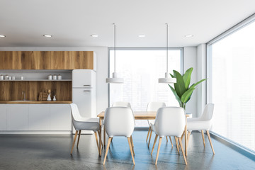 White and wooden kitchen interior with table