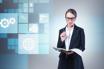 Fotobehang - Smart young woman with notebook, big data icons