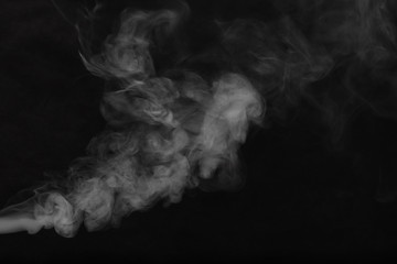 Fotorolgordijn Rook White smoke on a black background. Texture of smoke. Clubs of white smoke on a dark background for an overlay