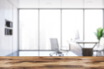 Table in blurry executive office interior