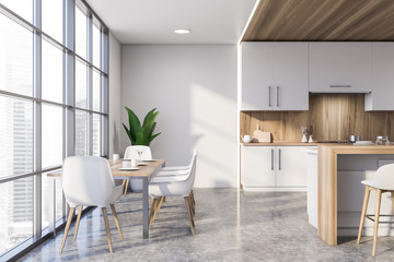 White and wooden kitchen with dining table