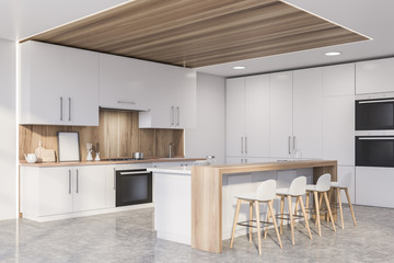 Corner of wooden kitchen with countertops and bar Fototapete