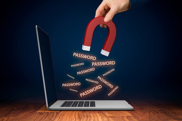 Leaked pwned passwords, data breach, cybersecurity and hacked stolen passwords concepts. Hand with magnet steal passwords from unprotected computer by spyware.
