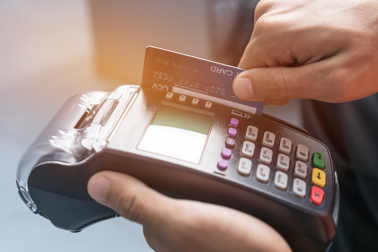 Payment with Mockup cardholder, credit card through terminal for purchase or sell products service, business button or swiping to buy shopping through electronic transaction in retail at store counter