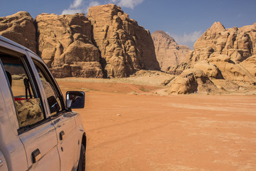 travel tour by car in Wadi Rum Easter desert landscape dry scenic nature environment picturesque rocky mountains background travel life style concept picture