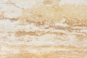 Polished surface of beautiful sand-colored Travertine. Background image, texture.