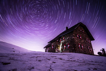 Night sky star trails above Wolfsberger hut, Wolfsberg, Carinthia, Austria