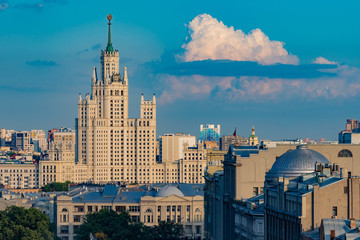 Moscow. Russia. Seven sisters. High-rise building on a background of blue sky. Moscow skyline. Roof of the building. Russian architecture. Traveling to the cities of Russia. Buildings of Moscow.