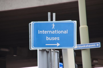 Direction sign to the bus stop for the international buses at Den Haag Central Station
