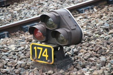 Red light sign between railroad track for stop train at railway station Den Haag Mariahoeve in the Netherlands