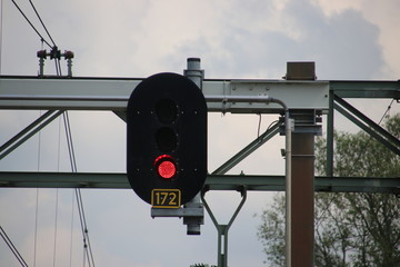 Red light sign above railroad track for stop train at railway station Den Haag Mariahoeve in the Netherlands