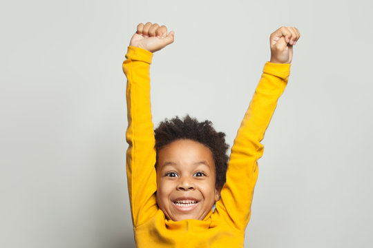 Happy African American child boy having fun on white background