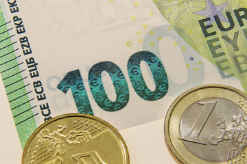100 Euro new banknote kind wit euro coins, detail, European Central Bank, Frankfurth