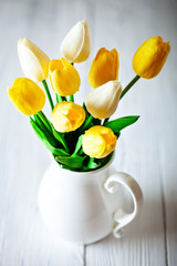 Bouquet of spring tulips on a bright background. Greeting card. Space for text.