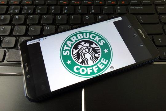 KONSKIE, POLAND - December 21, 2019: Starbucks Coffee logo on mobile phone