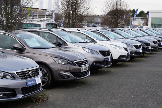 peugeot second hand parked automobiles line for sale in shop car sign dealership store