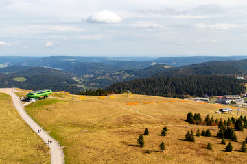 Scenic view from Feldberg tower at landscape of Black Forest in autumn with multi colored trees