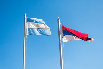 Flags of Argentina and Misiones Province against blue sky - Comandante Andresito, Argentina