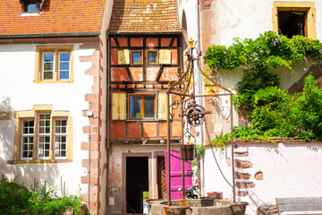 half-timbered architecture in Riquewihr in Alsace in France