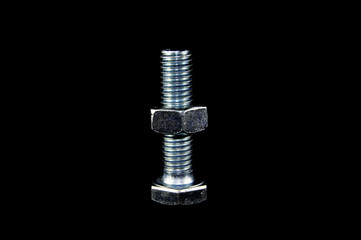 Steel bolt with nut on black background close-up