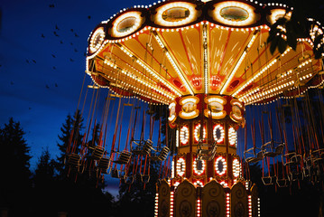 Canvas Prints Amusement Park Carousel Merry-go-round in amusement park at a night city
