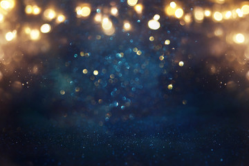 Fototapete - abstract glitter black, gold and blue lights background. de-focused