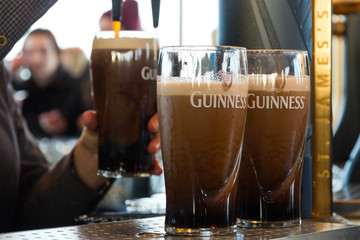 Guinness pints in a pub in Dublin Ireland on February 15, 2014.