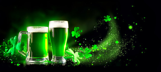St. Patrick's Day Green Beer pint over dark green background, decorated with shamrock leaves. Patrick Day pub party, celebrating. Glass of Green beer close-up. Border art design, Wide format banner