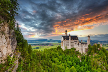 Neuschwanstein Castle in the Bavarian Alps at sunset, Germany Fototapete