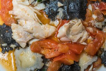 Delicious fish ravioli pasta with tomato sauce.