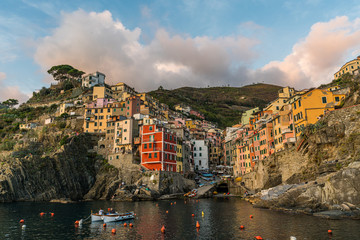 Stunning view of colorful Riomaggiore village at sunset in Cinque Terre, Italy.