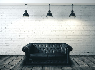 Brick interior with dark leather sofa