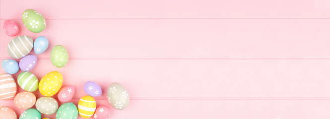 Wall Mural - Easter banner with pastel colored egg corner border over a pink wood background. Top view with copy space.