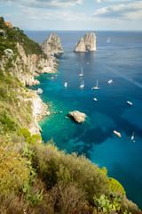 Zelfklevend Fotobehang Groen blauw Faraglioni rocks on Capri Island in Italy