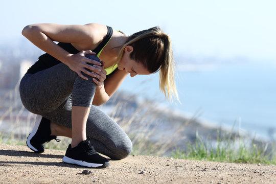 Injured runner complaining suffering knee ache