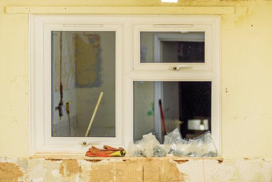 white plastic window in kitchen renovation in england uk