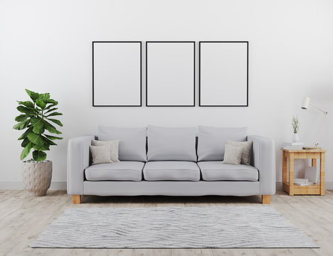 Three Vertical black poster frames mock up. Modern living room with grey sofa mockup. scandinavian style, cozy and stylish interior background, living room mock up, 3d rendering