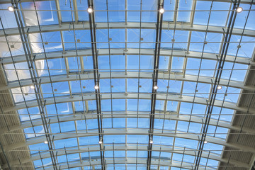 Hamburg, Germany, February 05, 2020: Semicircular roof construction of steel and glass in the modern building of the Hamburg exhibition halls under a blue sky