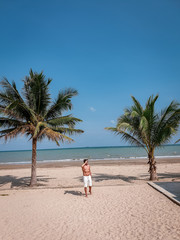 guy on the beach with palm tree and swimming pool in Thailand Chumphon area during sunset at Arunothai beach