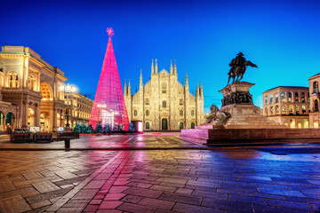 Milan Duomo cathedral square illuminated at Christmas time, Italy