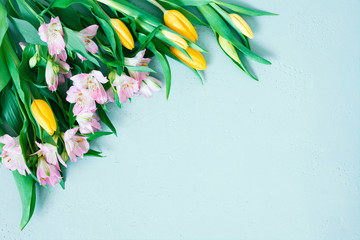 Wall Mural - Blue background with spring flowers, festive composition for spring holidays