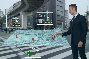 man use augmented mixed reality technology concept, its generate maps in virtual world with artificial intelligence , deep, machine learning, digital twin, 5G, industry 4.0 technology, virtual world