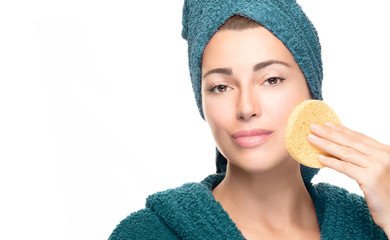 Healthy skin woman removing makeup with a cosmetic sponge pad. Skin care concept