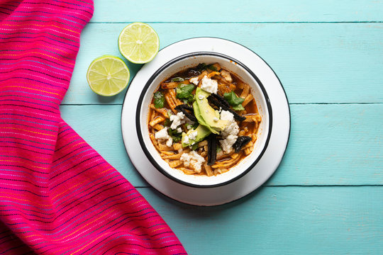 """Mexican tortilla soup also called """"azteca"""" on turquoise background"""