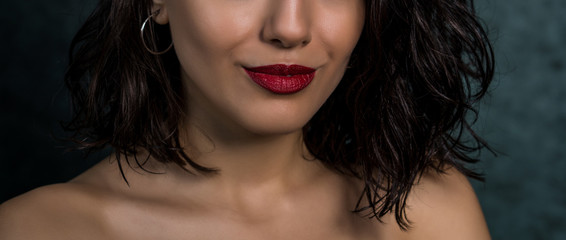 Close up macro photo view of beautiful girl lips with red matt lipstick. Part of face, young woman. Wall mural
