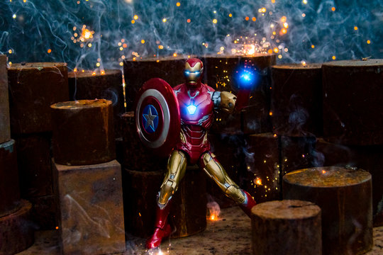 TOKYO, JAPAN - FEBRUARY 10, 2020 :  Fighting pose of Iron Man action figures in fire sparks. Iron Man is a fictional superhero appearing in American comic books published by Marvel Comics.