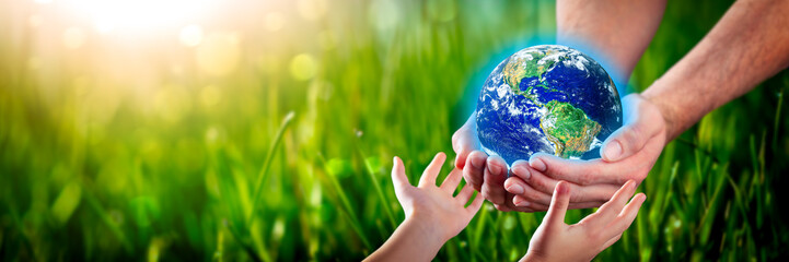 Wall Murals Nasa Hands Of Man Giving Earth To Child - Protect The Environment For Future Generations Concept - Some Elements Of This Image Provided By NASA